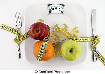 Fruits and vitamins with measuring tape on a plate like weight scale