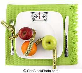 Diet concept. Fruits with measuring tape on a plate like ...