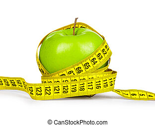 Diet concept. Green apple and yellow measuring tape on an isolat