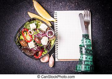 Diet concept, salad ingredients on black background . healthy food