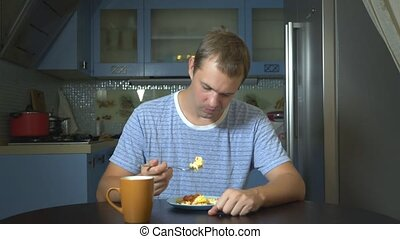 diet concept, tasteless food. Frustrated and annoyed man...