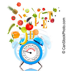Diet concept with clock, scale dial, fruits and vegetables.