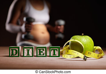 Word 'DIET' with apple, measuring tape and woman body