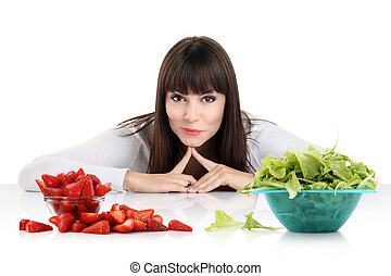 Diet. Dieting concept. Healthy Food. Beautiful Young Woman choosing between Fruits and Sweets. Weight Loss
