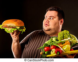 Diet fat man makes choice between healthy and unhealthy food.