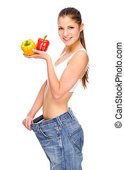 Full isolated studio picture from a young girl with big jeans and pepper