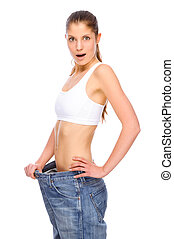 Full isolated studio picture from a young girl with big jeans
