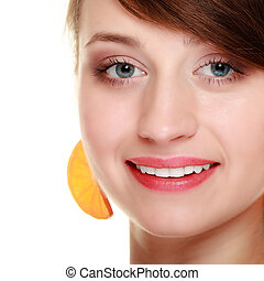 Diet. Girl with earrings of orange fruit isolated