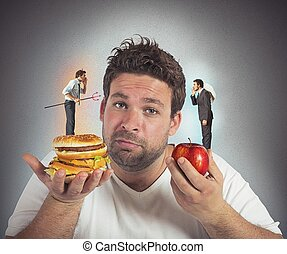 Diet guilty conscience - Man on diet with a guilty ...