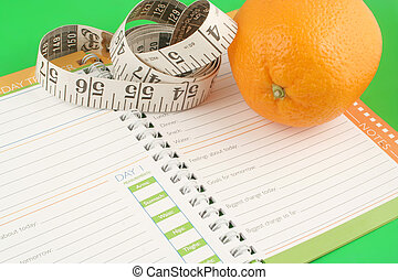 diet journal - a measuring tape, diet and nutrition journal...