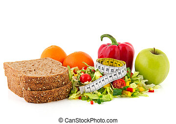 Diet meal with brown bread mixed salad and fruit and measuring tape