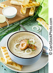Diet menu. Puree soup mushrooms with croutons in a bowl on a kitchen wooden table. The concept of healthy eating.