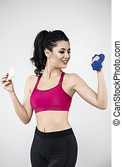 diet sporty young woman eating cereal bar