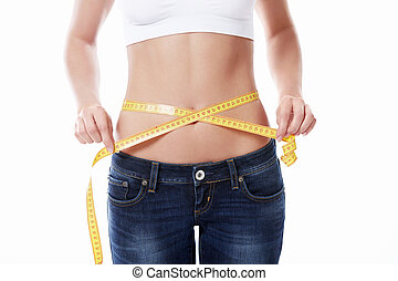 Diet - Young girl measuring waist on a white background