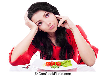 diet - upset young woman keeping a diet and eating...