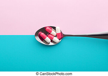 Diet supplement, pills in spoon