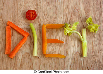 Diet - The word diet spelt out in vegetables on a wooden...