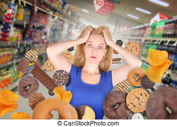 Diet Woman at Grocery Store with Junk Food - A woman has...