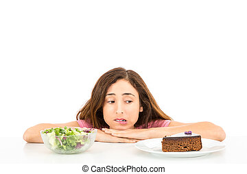 Diet woman deciding between cake and salad - Woman trying to...