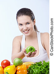 Diet - Young attractive girl offers an apple on a white ...
