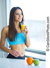 Diet. Young attractive happy woman with glass of juice