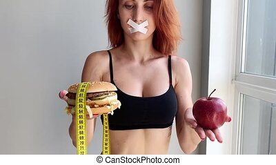 Diet. Young woman preventing her to eat junk food. Healthy eating concept.