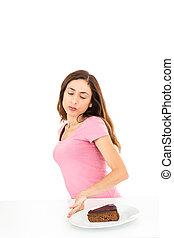 dieta, mulher, empurrar, afastado, um, pedaço bolo