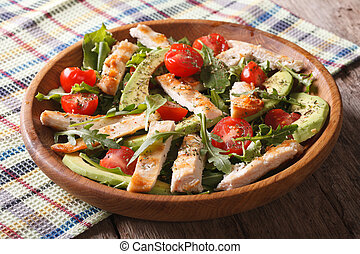 Dietary chicken salad with avocado, arugula and cherry tomatoes