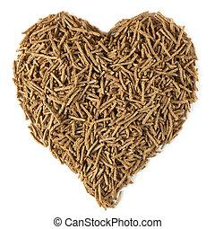 Dietary Fiber for Heart Health - Bran in a heart shape,...