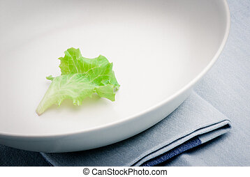dietary food - a leaf of lettuce on dish