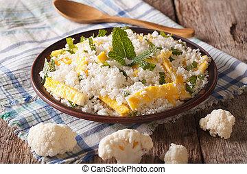 Dietary food: cauliflower rice with scrambled eggs. horizontal