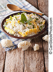 Dietary food: cauliflower rice with scrambled eggs. Vertical