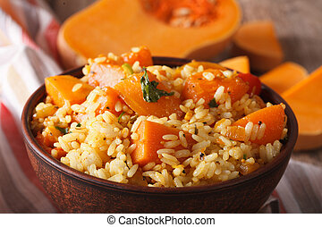 Dietary food: rice with pumpkin macro on the table. ...