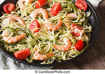 Dietary food: zucchini pasta with shrimp closeup. horizontal...