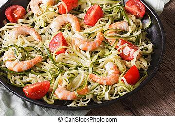 Dietary food: zucchini pasta with shrimp closeup. horizontal...