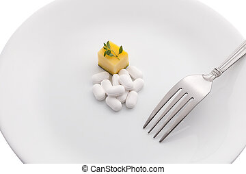 Dietary supplements on white plate