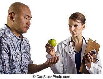 Dietician with apple - doctor prescribing proper diet to...