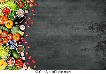 Dieting and healthy eating concept: fruits, vegetables, vegan food, nutrition ingredients over natural background.