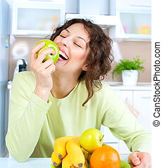 Dieting concept. Healthy Food. Young Woman Eats Fresh Fruit