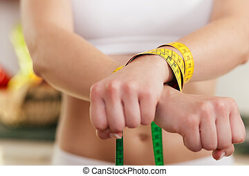 Dieting gone wild - Woman handcuffed