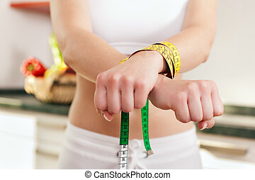 Dieting gone wild - Woman handcuffed - Woman handcuffed by a...