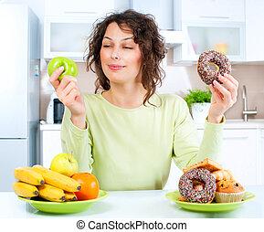 dieting, kobieta, concept., między, młody, słodycze, wybierając, owoce