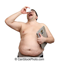 dieting overweight man with medicaments and scales