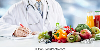 Dietitian writing a prescription for healthy diet