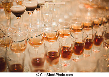 Different Alcohol Drinks In Goblets And Wine Glasses On