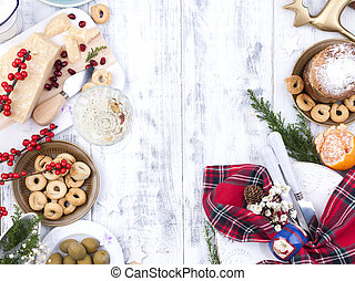 Different appetizers and razdnichnaya table setting for a party. Celebration of Christmas in the company. Table with food top view. Free space for text in the center.