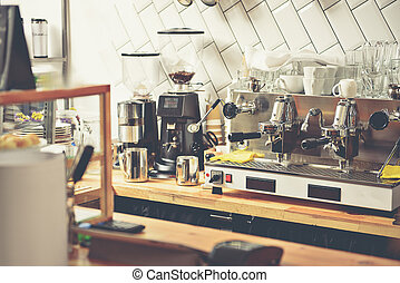 Different appliances on under-counter cabinets in espresso...