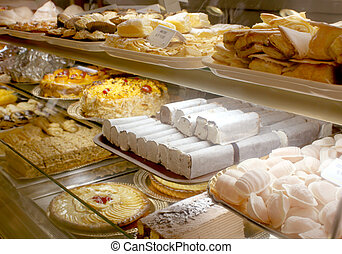 Portuguese bakery - different baked goods at a Portuguese...