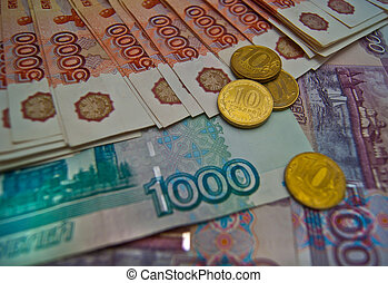 Different banknotes and coins background