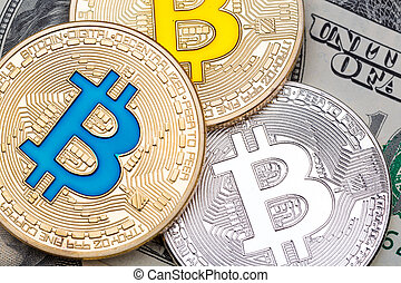 Different bitcoin coins on dollar background.